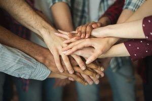Personal Injury Lawyers joining hands in Richmond VA